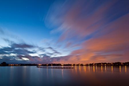 leidschendam: Impressive clouds above a blue lake at night