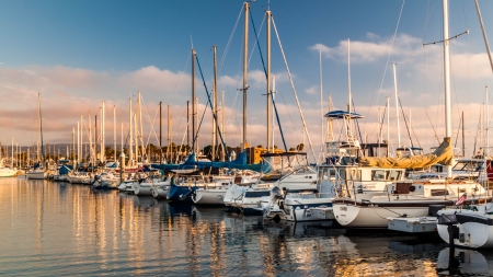 ca: Boats and small yachts aligned in a Californian Marina at sunset Stock Photo