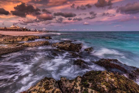riviera maya: Purple sunset over a tropical rocky beach, Riviera Maya, Yucatan, Mexico Stock Photo