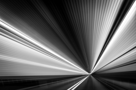 vanish: Black and white abstract  time-warp  photo taken from a moving car inside Holland Tunnel