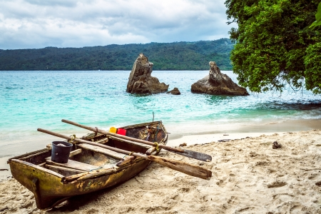 bacardi: Old fishing boat pulled on the beach in Cayo Levantado - Dominican Republic