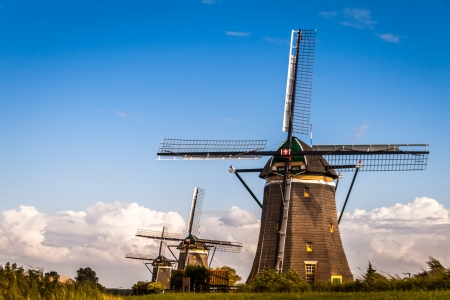 Three historical Dutch windmills in Stompwijk, near The Hague photo