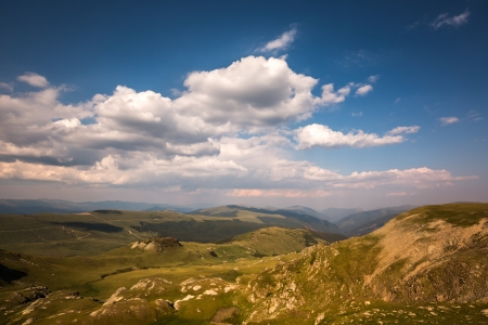 oudoors: Landscape with a blue sky and white clouds above the Carpathian mountains