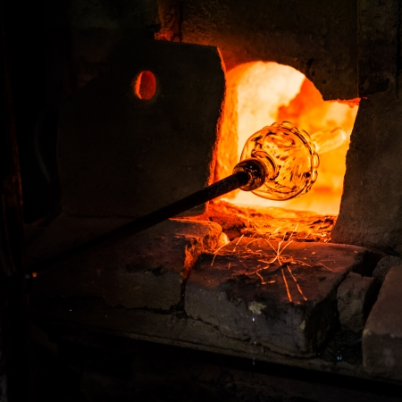 glassblower: Glass manufacturing in a Murano oven