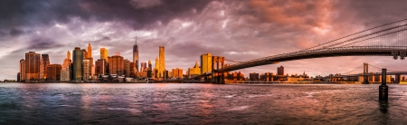 scenics: Dramatic sunrise over the Lower Manhattan and the Brooklyn Bridge as viewed from the Brooklyn Bridge Park