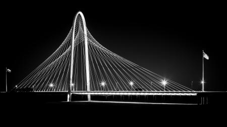 Margaret Hunt Hill bridge by night in Dallas, USA  Margaret Hunt Hill Bridge is a Santiago Calatrava-designed bridge built over the Trinity River
