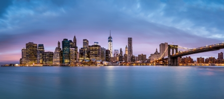 New York Financial District and the Lower Manhattan at dawn viewed from the Brooklyn Bridge Park  photo