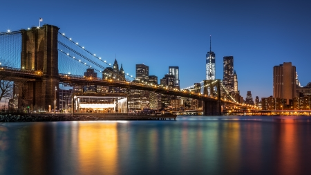 Brooklyn Bridge at dusk viewed from the Brooklyn Bridge Park in New York City  photo