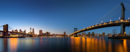 Dusk panorama with the downtown New York City skyline and the  Two Bridges   Brooklyn Bridge and Manhattan Bridge  viewed from Brooklyn Bridge Park, across the East River