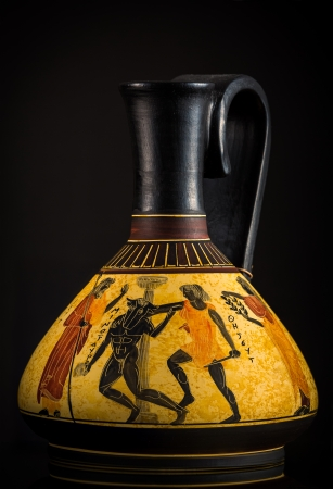 myth: Ancient Greek vase sold as a souvenir in Crete  The vase depicts the Minotaur  a creature with the head of a bull on the body of a man  being slayed by Theseus