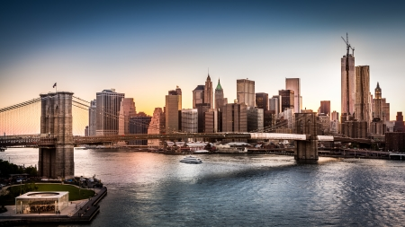 freedom tower: Brooklyn Bridge and the Lower Manhattan at sunset in New York City