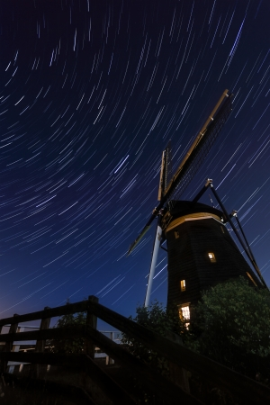 Startrails above an old Dutch windmill photo