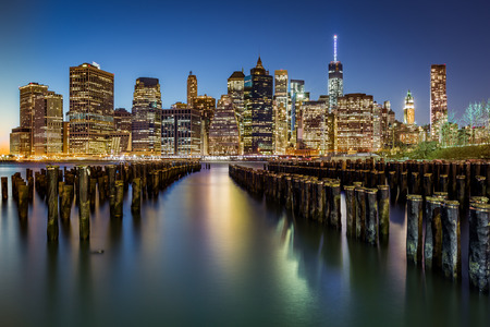 Lower Manhattan and dusk behind an old Brooklyn pier photo