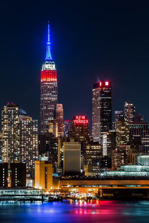 empire state building:  Empire State Building by night  The top of the iconic skyscraper displays the American flag colors, blue-white-red, in honor of Presidents  Day  Editorial