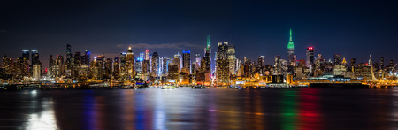New York skyline panorama by night on Saint Patricks Day
