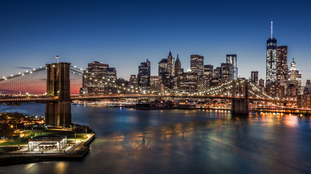 Brooklyn Bridge and Downtown Manhattan at dusk Stock Photo