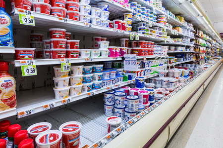 refrigerator with food: Cultured dairy products aisle in an American supermarket
