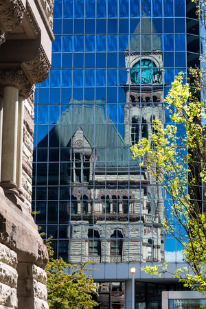 municipal court: Old and new in Toronto  The Old City Hall mirrored on a modern glass building