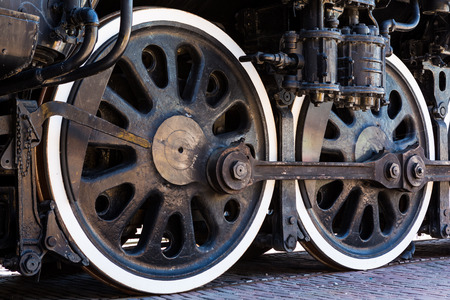 Pair of old locomotive wheels photo