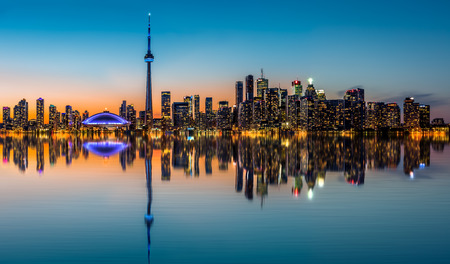 Toronto skyline at dusk, reflected in  the Inner Harbor Bay photo