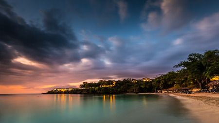 Caribbean sunset over a Jamaican cove Stock Photo