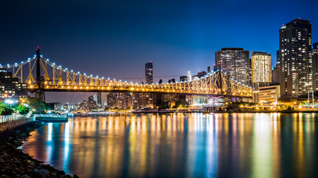 Queensboro bridge by night viewed from Roosevelt island, New York Stock Photo