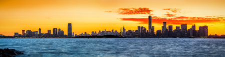 Panorama with Jersey City and New York City skylines at sunrise photo
