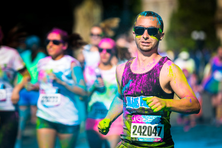 vibe: Young man runs the Color Vibe 5K race in Morristown, New Jersey  Color Vibe is a fun un-timed event with no winners or prizes where runners are showered with colored powder along the run