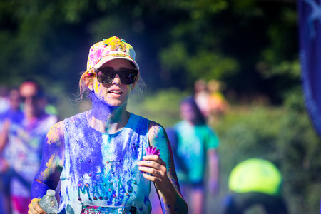 vibe: Young woman runs the Color Vibe 5K race in Morristown, New Jersey  Color Vibe is a fun un-timed event with no winners or prizes where runners are showered with colored powder along the run