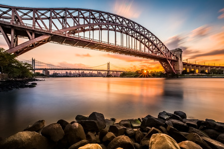 steel arch bridge: Hell Gate and Triboro bridge at sunset, in Astoria, Queens, New York Stock Photo