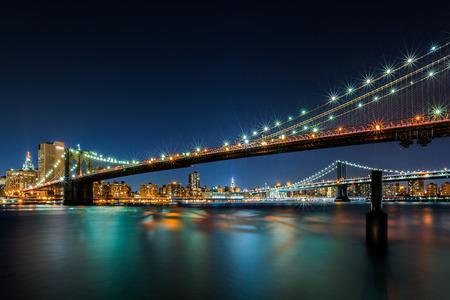 Illuminated Brooklyn Bridge by night