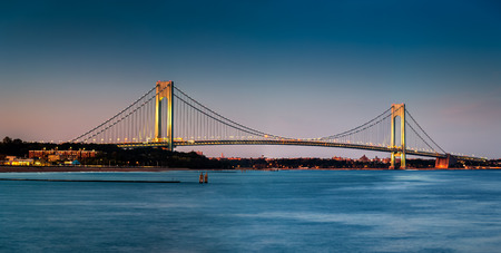bridging: Verrazano-Narrows Bridge at dusk, as viewed from Ocean Breeze Fishing Pier, in Staten Island, New York Stock Photo