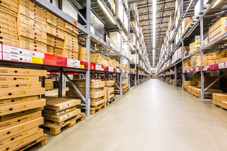 Warehouse aisle in an IKEA store. Founded in 1943, IKEA is the world\'s largest furniture retailer