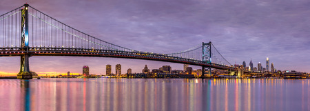 ben franklin: Panoramic view of the Ben Franklin bridge and Philadelphia skyline, under a purple sunset