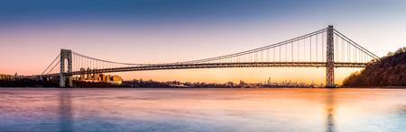 George Washington Bridge panorama above the New York skyline at sunset Stock Photo