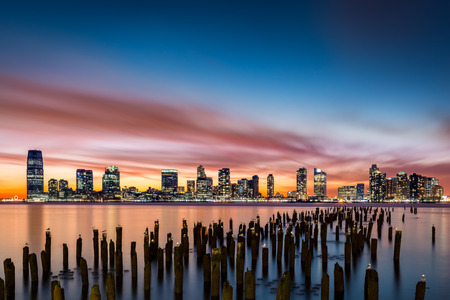 water birds: Jersey City skyline at sunset as viewed from Tribeca, New York across the Hudson River