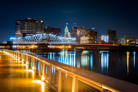 new building: Newark, NJ cityscape by night, viewed from Riverbank park. Jackson street bridge, illuminated, spans the Passaic River Stock Photo