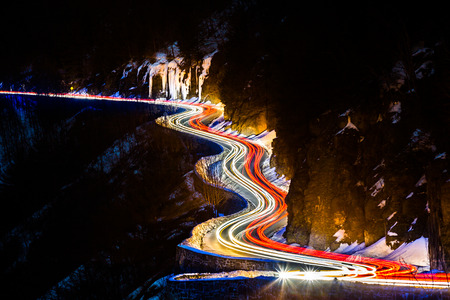 light trails: Traffic light trails on the Hawks Nest road in upstate New York Stock Photo
