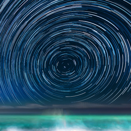 Star-trails above the Caribbean sea, in a Jamaican resort, with the Northern Star in the center of the image.