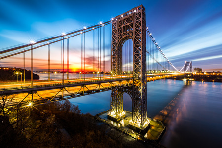 George Washington Bridge at sunrise in Fort Lee, NJ. George Washington Bridge is a suspension bridge spanning the Hudson River connecting NJ to Manhattan, NY.