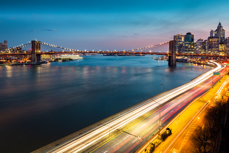 night highway: Brooklyn Bridge and with traffic trails on the FDR drive at dusk