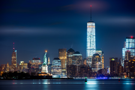 new york skyline: New York City and its three iconic landmarks: Statue of Liberty Freedom Tower and Empire State Building