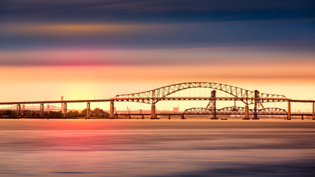 steel arch bridge: Newark Bay Bridge and sunset. Newark Bay Bridge officially known as Vincent R. Casciano Memorial Bridge connects the NJ cities of Newark and Bayonne. Stock Photo