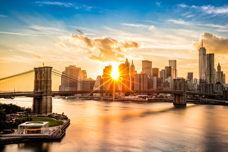nyc: Brooklyn Bridge and the Lower Manhattan skyline at sunset as viewed from Manhattan Bridge Stock Photo