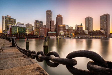 Boston skyline at sunset as viewed from Fan Pier Park. Stock Photo