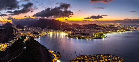 Panoramic view of Rio de Janeiro on a hazy night, as viewed from Sugar Loaf peak. Stock Photo