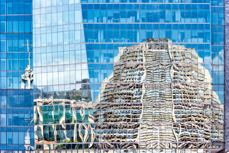 mirrored: Metropolitan Cathedral mirrored on a modern building facade, in Rio de Janeiro, Brazil