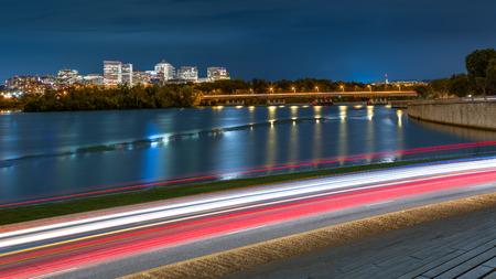 rosslyn: Rosslyn Skyline, Theodore Rosevelt Memorial Bridge and traffic trails on Ohio Drive, in Washington DC Stock Photo