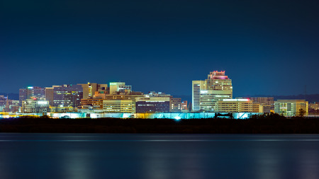 Wilmington skyline by night, viewed from New Jersey, across the Delaware River. Wilmington is the largest city in the state of Delaware.