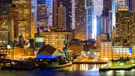 intrepid: Midtown Manhattan skyscrapers border Hudson River near pier 86, Stock Photo
